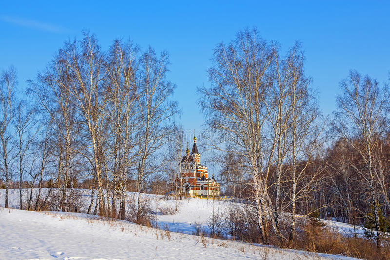 Siberian winter landscape with Church royalty free stock images