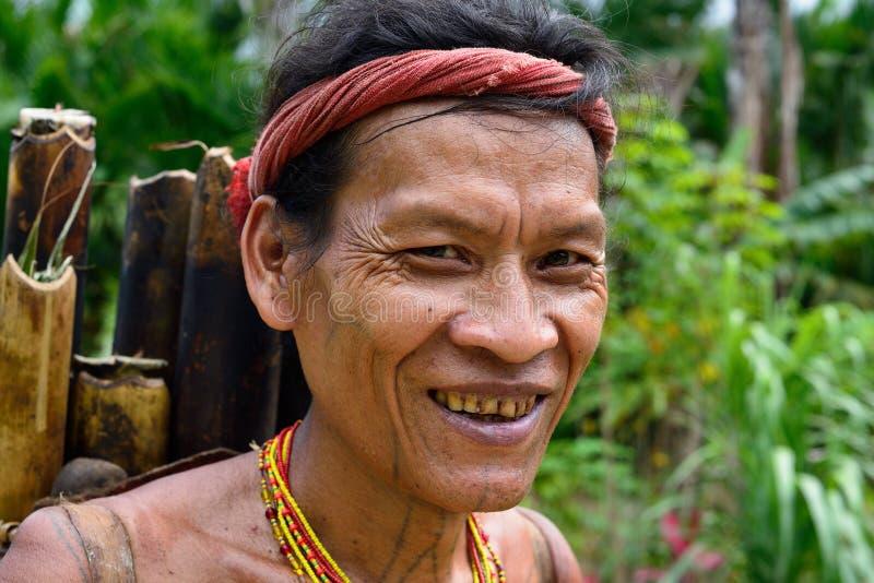 Siberut, Portrait  tribal mentawai woman, with traditional tattoos. Muara Siberut, Mentawai Islands, Indonesia, 5 NOVEMBER 2019: Portrait  tribal men with royalty free stock images