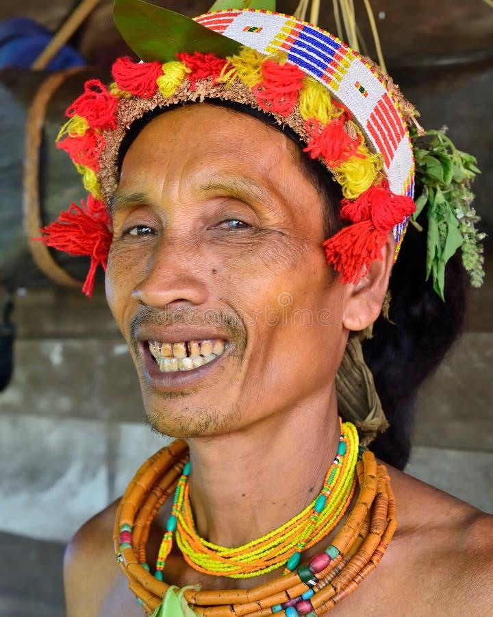 Siberut, Portrait  tribal mentawai man, with traditional tattoos. Muara Siberut, Mentawai Islands, Indonesia, 3 NOVEMBER 2019: Portrait  tribal men - shaman royalty free stock photography