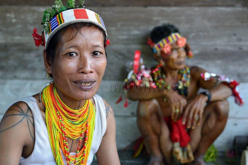 Siberut, Portrait  tribal mentawai woman, with traditional tattoos. Muara Siberut, Mentawai Islands, Indonesia, 3 NOVEMBER 2019: Portrait  tribal woman - shaman royalty free stock photos