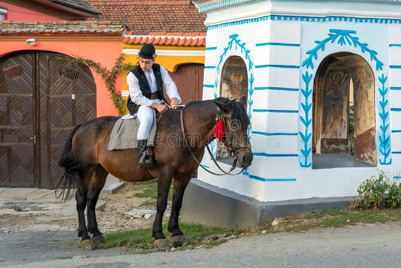 SIBIEL, TRANSYLVANIA/ROMANIA - SEPTEMBER 16 : Young man in traditional dress on a horse in Sibiel Transylvania Romania on. September 16, 2018. One unidentified stock photos