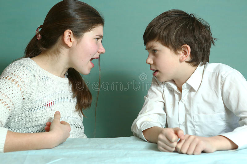 Sibilngs boy and girl arguing. Teen brother and sister sibilngs boy and girl arguing close up photo royalty free stock images