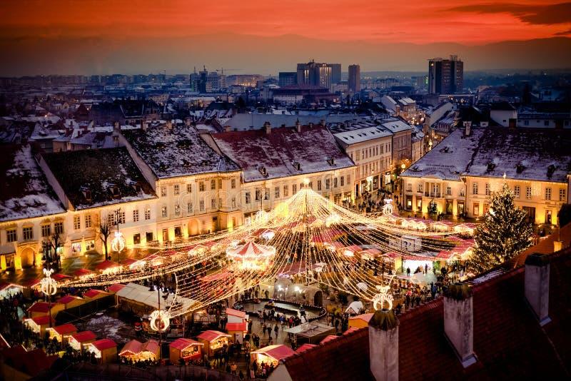 Sibiu Christmas Market Transylvania Romania. Sibiu Christmas Market in the main square, Transylvania Romania. Beautiful sunset in the heart of Transylvania. City stock images