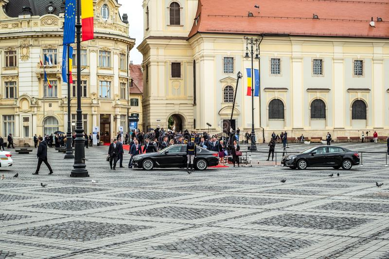 Officials entering the cars. Sibiu City, Romania - 9 May 2019. European Officials entering the cars at Informal meeting of heads of state or government 2019 in stock images