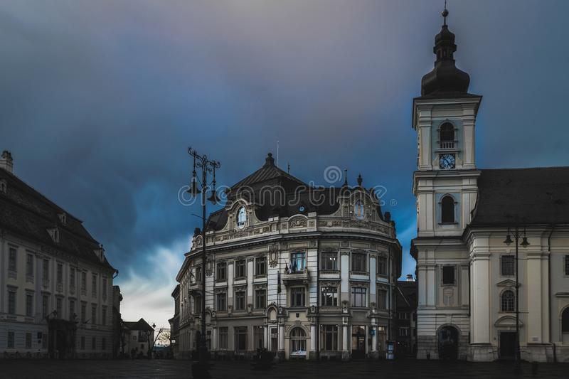Sibiu old buildings in the big square at dusk royalty free stock photography