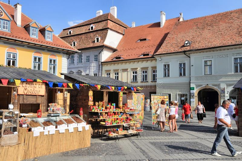 Sibiu, Romania. AUGUST 24, 2012: People visit Piata Mica square in . Sibiu`s tourism is growing with 284,513 museum visitors in 2001 and 879,486 visitors in stock images