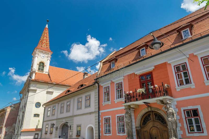 Sibiu, Romania - Beautiful street with Reformed Church and House with Caryatides on a sunny summer day in Sibiu, Romania royalty free stock photo