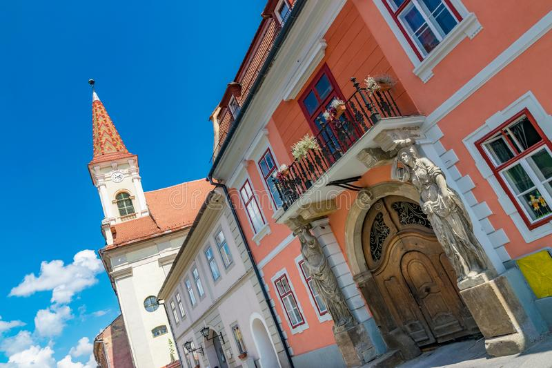 Sibiu, Romania - Beautiful street with Reformed Church and House with Caryatides on a sunny summer day in Sibiu, Romania royalty free stock image