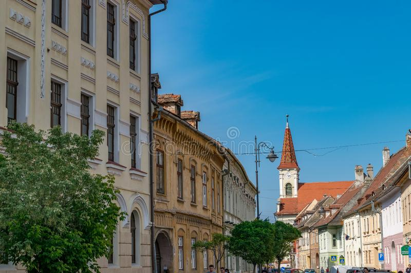 Sibiu, Romania - Beautiful street with Reformed Church on a sunny summer day in Sibiu, Romania stock photography