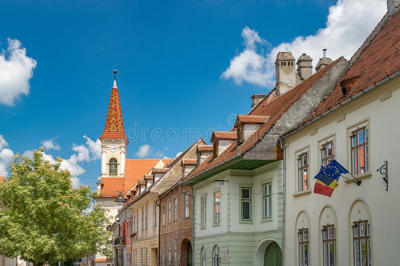 Sibiu, Romania - Beautiful street with Reformed Church on a sunny summer day in Sibiu, Romania royalty free stock photography