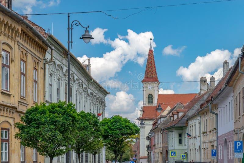 Sibiu, Romania - Beautiful street with Reformed Church on a sunny summer day in Sibiu, Romania royalty free stock photo