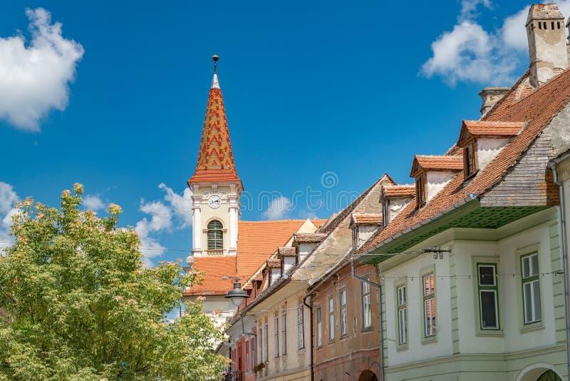 Sibiu, Romania - Beautiful street with Reformed Church on a sunny summer day in Sibiu, Romania royalty free stock image