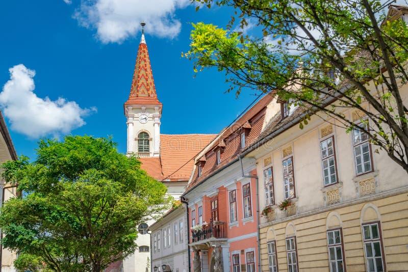 Sibiu, Romania - Beautiful street with Reformed Church on a sunny summer day in Sibiu, Romania stock photo