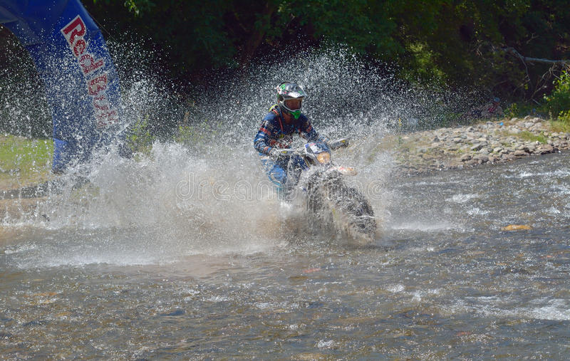 SIBIU, ROMANIA - JULY 18: A copetitor in Red Bull ROMANIACS Hard Enduro Rally with a KTM motorcycle. The hardest enduro rally in stock photography
