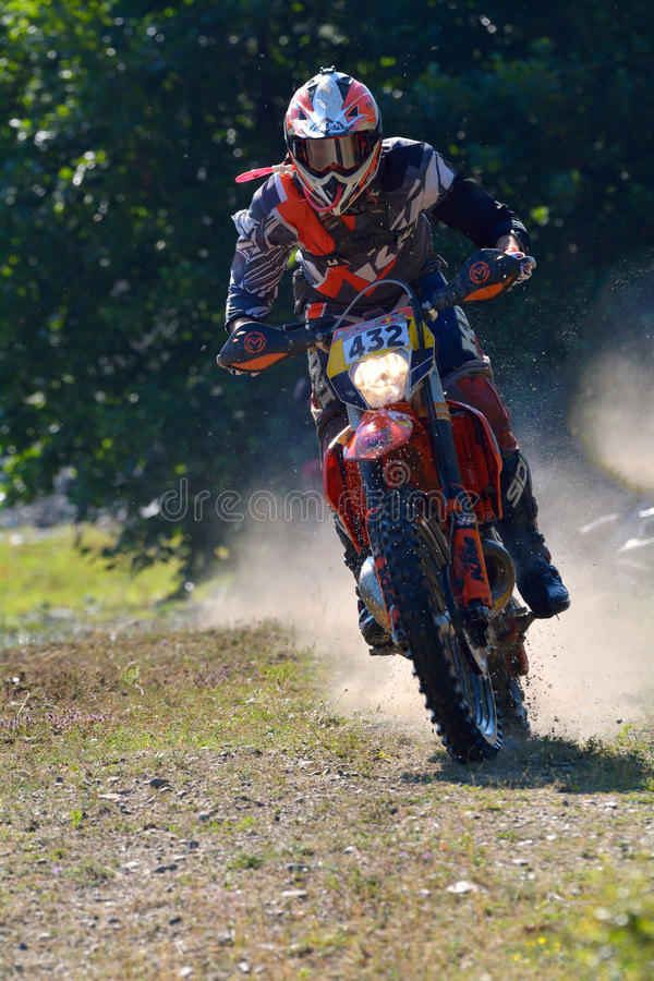 SIBIU, ROMANIA - JULY 18: Stefan Muntean competing in Red Bull ROMANIACS Hard Enduro Rally with a enduro motors motorcycle. royalty free stock photo