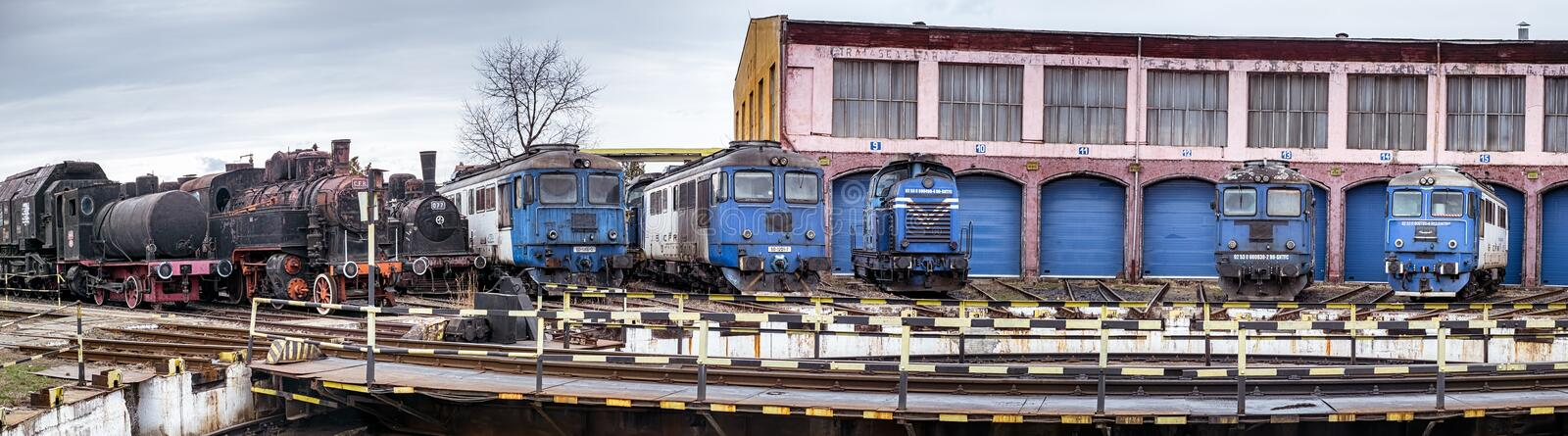 Railway depot with old steam and modern diesel locomotives royalty free stock photo