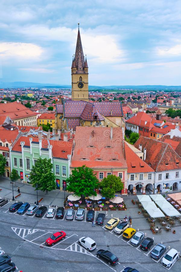Aerial view of the Small Square Piata Mica in Sibiu, with imposing watch tower of Lutheran Cathedral of Saint Mary in the back. Sibiu, Romania - May 27, 2019 stock images