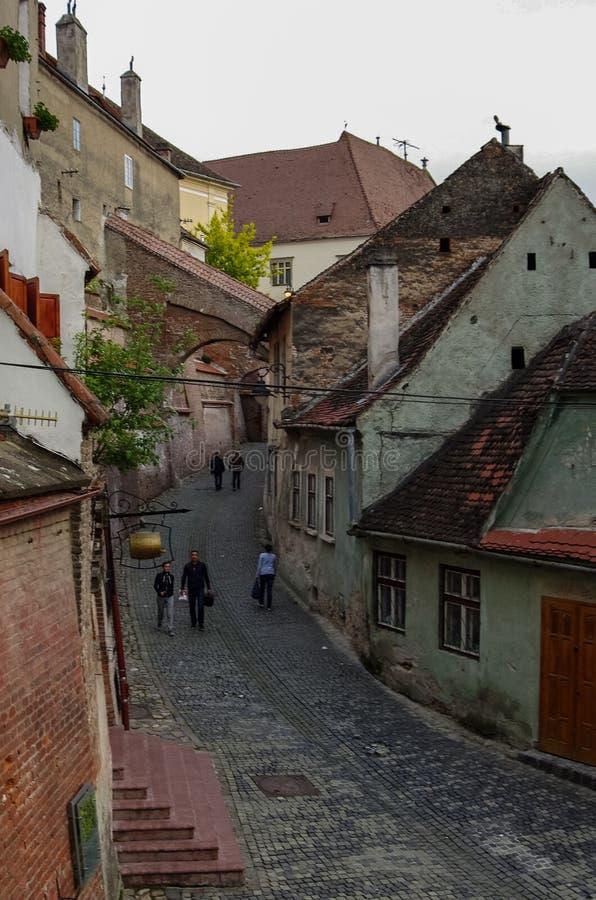 Downtown street with old buildings. Sibiu, Romania stock photos