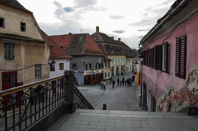 Downtown street with old buildings. Sibiu, Romania stock photo