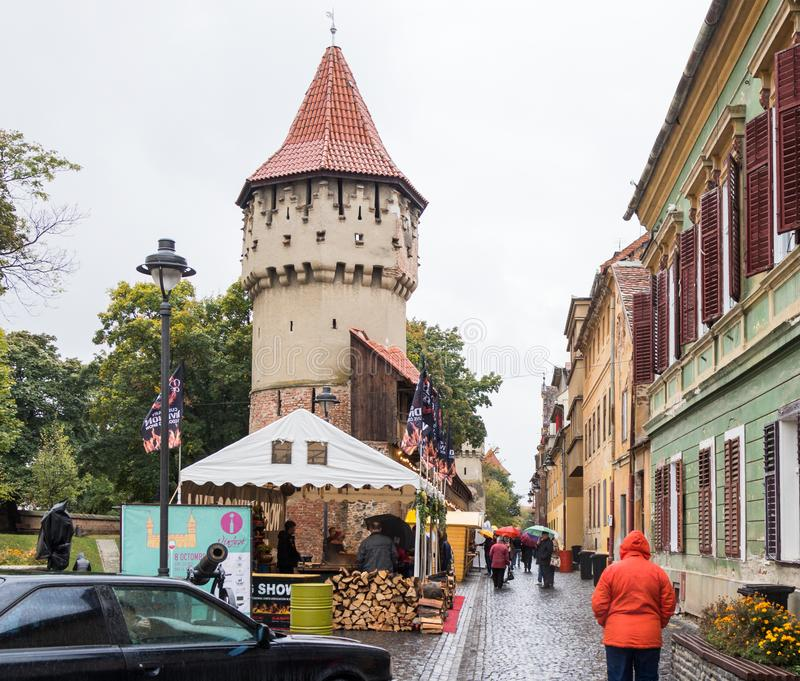 The famous Tower of the Carpenters - Turnul Dulgherilor - on the Cetatii street in a rainy day. Sibiu city in Romania royalty free stock photo