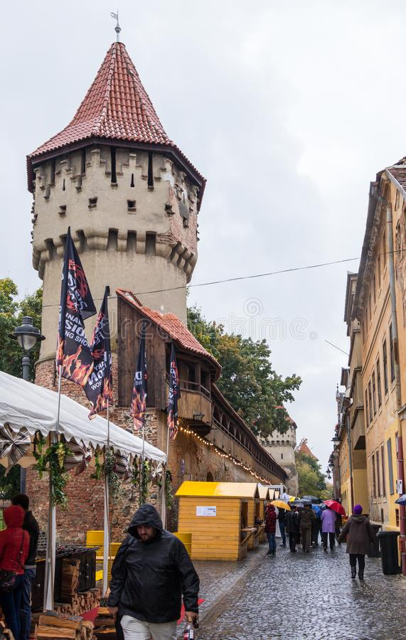 The famous Tower of the Carpenters - Turnul Dulgherilor - on the Cetatii street in a rainy day. Sibiu city in Romania stock photography