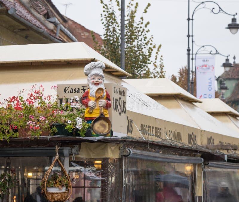Figurine dwarf at the corner of the cafe in Sibiu city in Romania. Sibiu, Romania, October 07, 2017 : Figurine dwarf at the corner of the cafe in Sibiu city in royalty free stock image