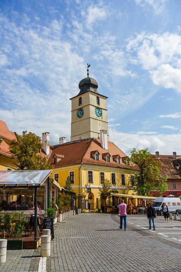 Sibiu, Romania - 2019. People wandering on the street of Sibiu near the Council Tower Turnul Sfatului royalty free stock image