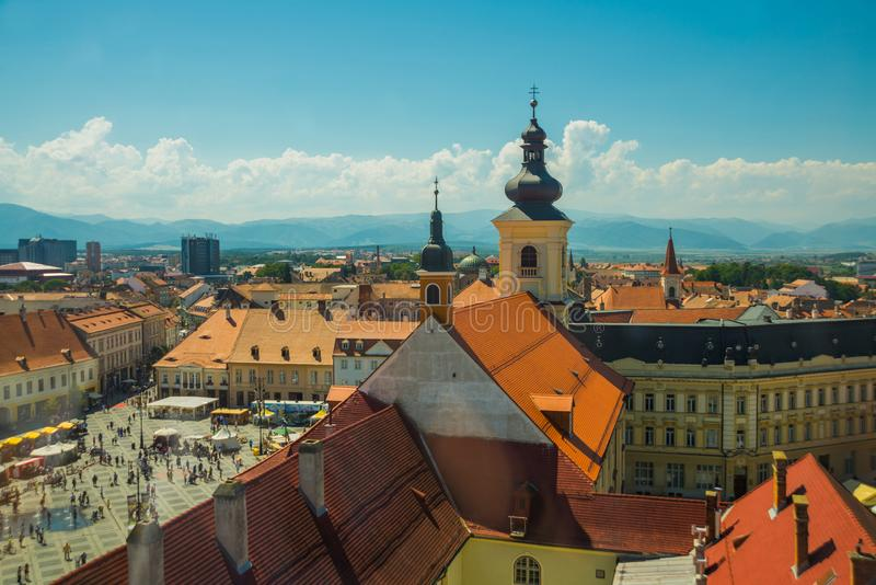 SIBIU, ROMANIA: Sibiu`s council tower in the small swuare on a sunny summer day with a blue sky in Sibiu. SIBIU, ROMANIA : Sibiu`s council tower in the small royalty free stock photography