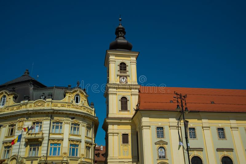 SIBIU, ROMANIA: Sibiu`s council tower in the small swuare on a sunny summer day with a blue sky in Sibiu. SIBIU, ROMANIA : Sibiu`s council tower in the small stock images