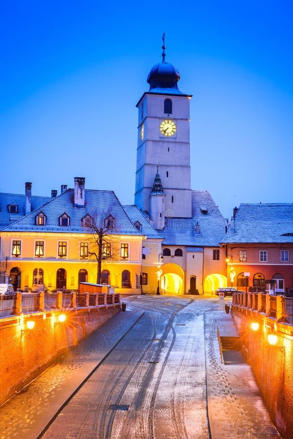 Sibiu, Transylvania, Romanai. Sibiu, Romania. Twilight image of Council Tower in Small Square, Transylvania stock photo