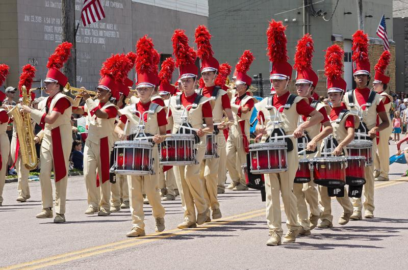 Sibley Band Marches Through Street at Mendota Parade. Mendota, Minnesota/USA - July 13, 2019: The Sibley High School Marching Band performs in the street at royalty free stock photos
