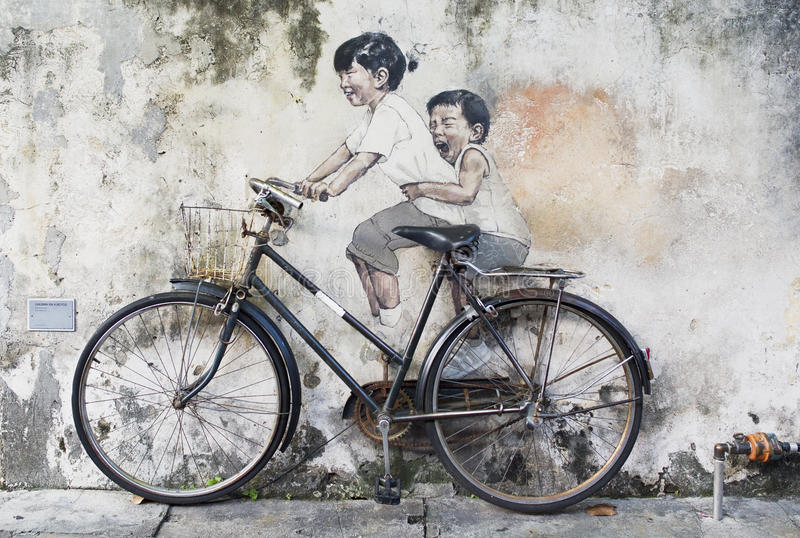 Sibling Cyclist Street Art Mural in Georgetown, Penang, Malaysia royalty free stock photos