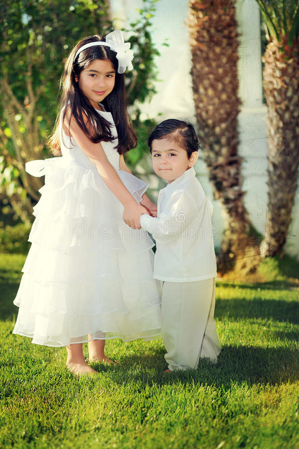 Siblings. Adorable brother and sister holding hands stock photos