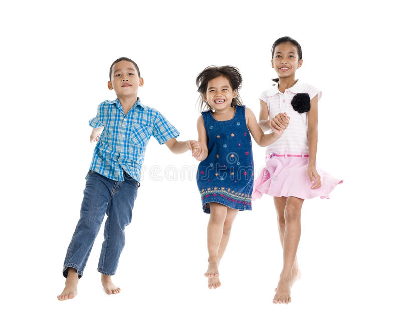 Siblings in action stock photography
