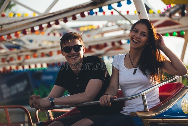Siblings at an amusement park stock photography