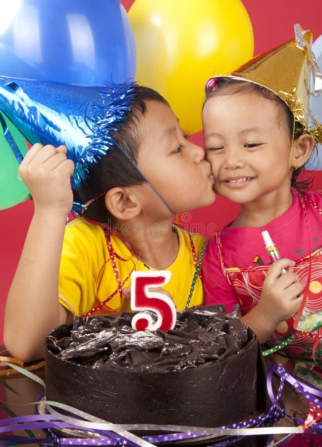 Siblings celebrating birthday royalty free stock photos