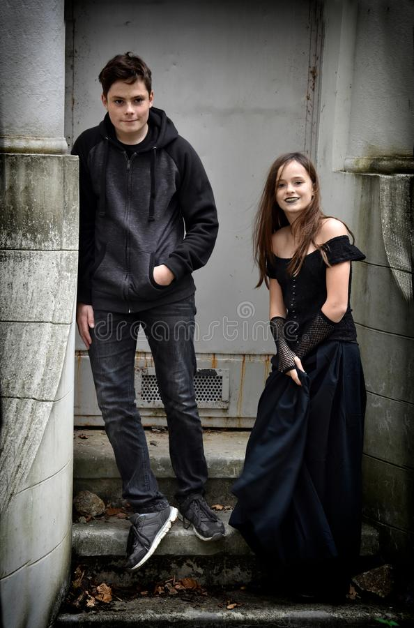 Siblings dressed in black in a spooky surrounding royalty free stock photos