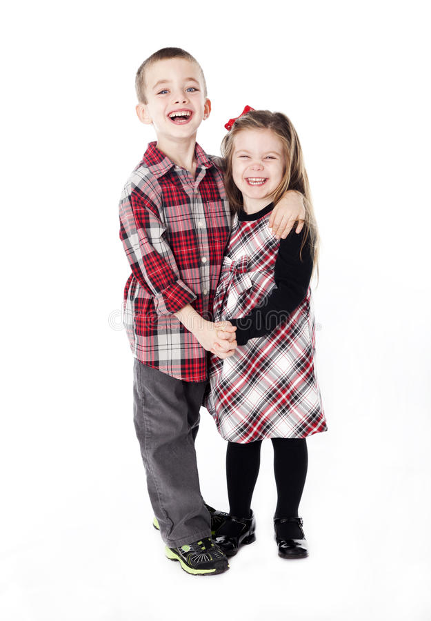 Siblings Embracing In Holiday Clothes Royalty Free Stock Image