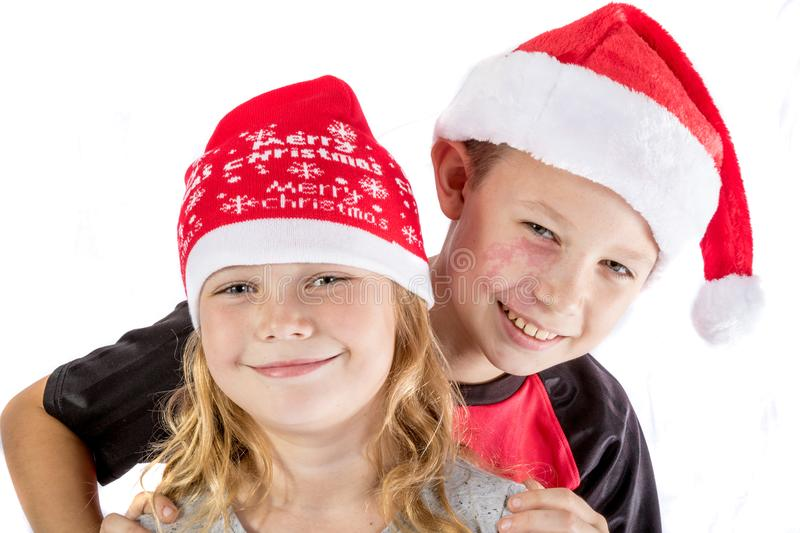 Siblings embrance for christmas stock photos