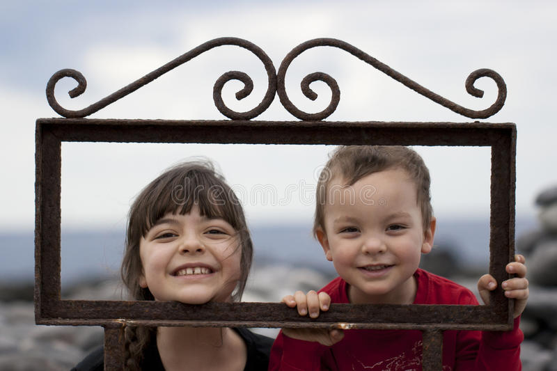 Siblings in frame royalty free stock photo