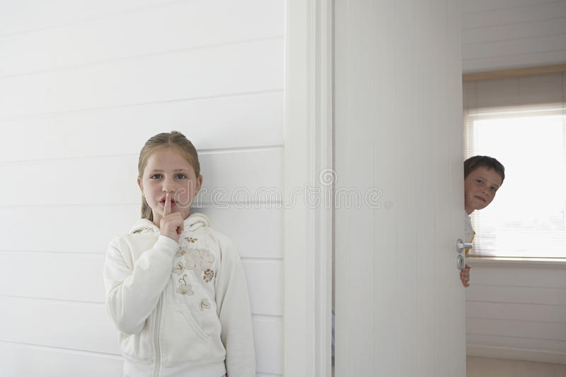 Siblings Playing Hide And Seek stock image