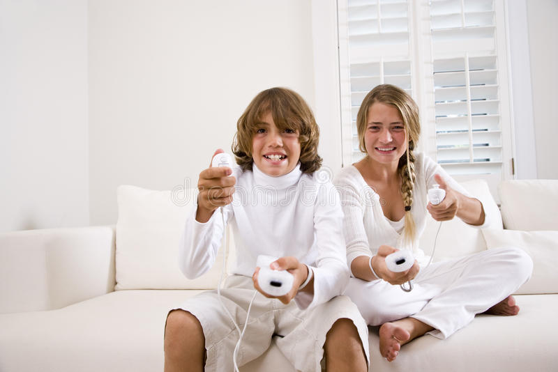 Download Siblings Playing Video Game Stock Photo - Image of expression, girl: 11024770