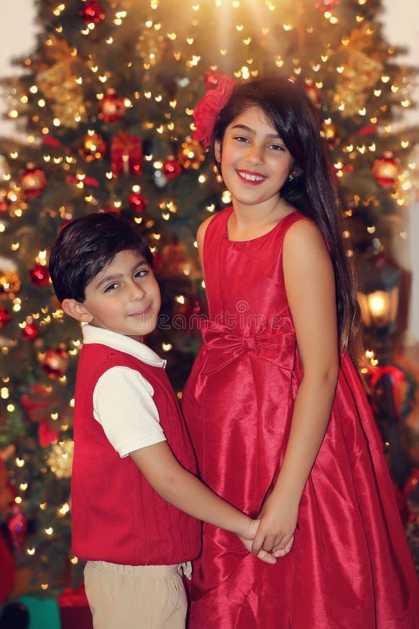 Siblings in red stock image