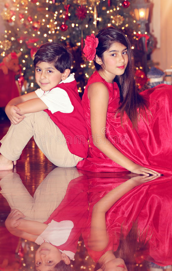 Siblings in red royalty free stock image