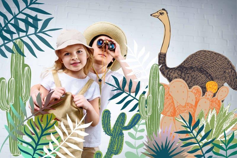siblings in safari costumes hugging and looking in binoculars at cactuses vector illustration