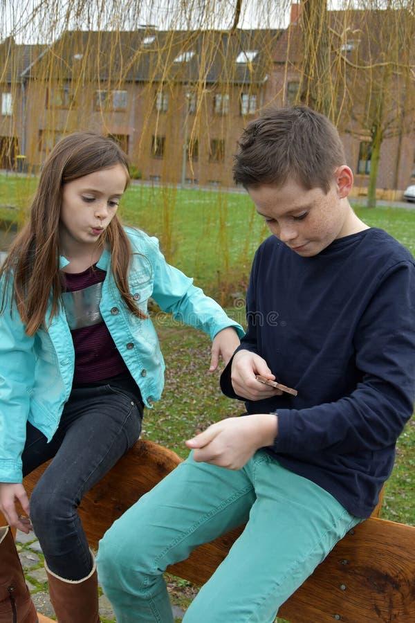 Siblings sharing chocolate stock image