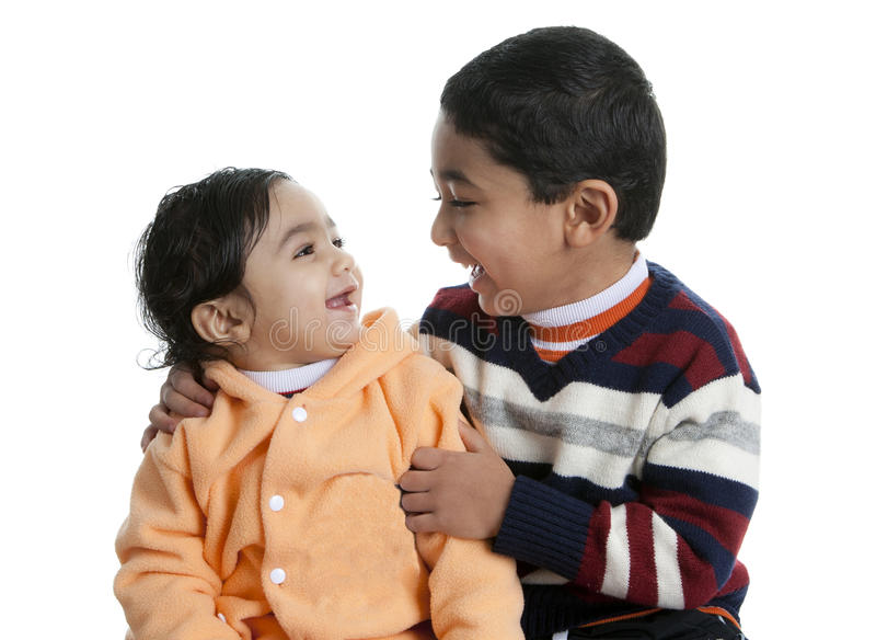 Siblings Sharing a Laugh. Isolated, White royalty free stock photos
