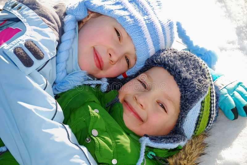 Siblings in snow stock photography