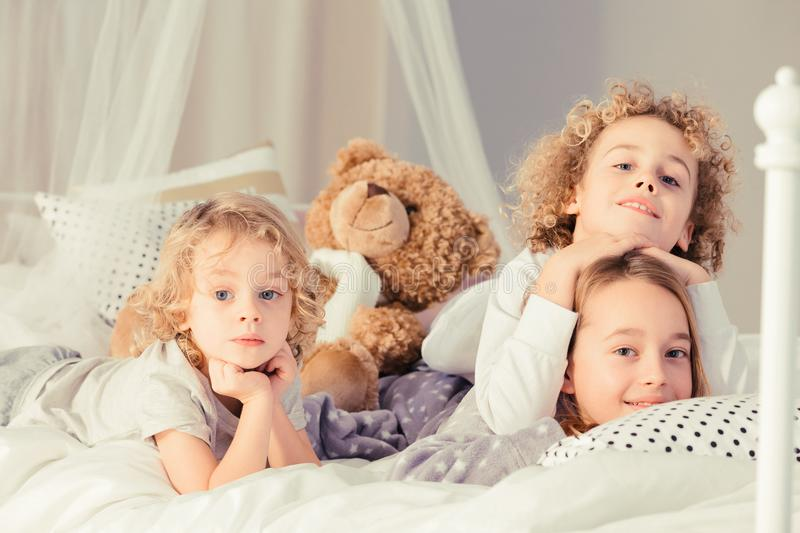 Siblings with teddy bear royalty free stock image
