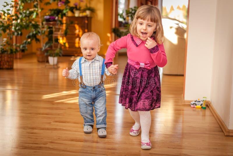 Siblings walking together royalty free stock image